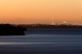 Auckland NZ distant citylight skyline after sunset Royalty Free Stock Photo