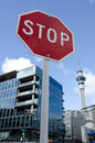 Auckland real estate market nz may stop sign under the skytower on may house prices are booming around new zealand with the Royalty Free Stock Photos