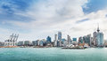 Auckland view at the noon skyline of with city central business district and port cranes cloudy Stock Images