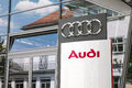 Audi sign infront of an dealership with copy space to the left Stock Photography