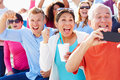 Audience cheering at outdoor concert performance smiling Stock Photos