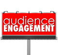 Audience engagment billboard advertising customers outreach engagement words on a red to illustrate communication with and Stock Photos