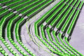 Audience seats green rows of chairs at an outdoor stadium Stock Photos