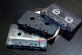 Audio cassette tapes photo of retro jvc philips and sony long play vinyl record in background Stock Photo