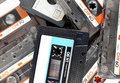 Audio compact cassettes, background Royalty Free Stock Photo