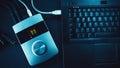 Audio converter and laptop on black table blue illumination Royalty Free Stock Photography