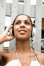 Audio joy a young hispanic girl enjoying music outdoor Royalty Free Stock Photo