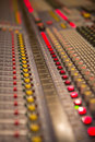 Audio mixer mixing board fader and knobs at night during a live concert Royalty Free Stock Image