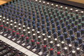 Audio mixer mixing console in a recording studio faders and knobs of a sound Royalty Free Stock Image