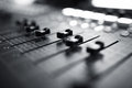 Audio mixing console professional with faders and adjusting knobs tv equipment black and white selective focus Royalty Free Stock Photography