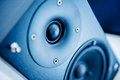 Audio speaker on in blue technological background Royalty Free Stock Images