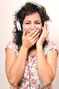 Audio surprise a young woman listening music with headphones Stock Photo