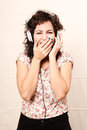 Audio surprise a young woman listening music with headphones Royalty Free Stock Images