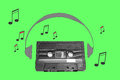 Audiotape and headphone draw on green Royalty Free Stock Photo