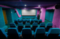 Auditorium in cinema theatre with empty seats with green illumination Stock Photo