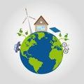 Auf grünem planeten ist eine erde mit blauen ozeanen ein behagliches haus und alternativenergiequellen windmühle solarbatterie Lizenzfreie Stockfotos