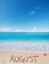 August on a tropical beach under clouds Royalty Free Stock Photo