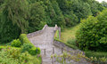 The Auld Brig at Alloway in Ayrshire from the Burns memorial gardens Royalty Free Stock Photo