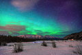 Aurora borealis in alaska beautiful green northern light at knik river Stock Photos