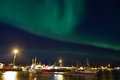Aurora borealis over harbour Stock Photography