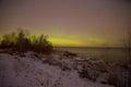 Aurora borealis over  Ladoga Lake on the March night. Pyatirechye, Leningrad region. Russia Royalty Free Stock Photo
