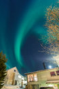 Aurora borealis over suburban houses in Tromso Royalty Free Stock Photo