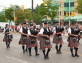 Aurora ontario canada july irishmen in their kilt playing their bagpipes during the canada day parade at part of young street Stock Image