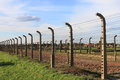 Auschwitz birkenau concentration camp barbed wire electrical fence at poland Stock Images