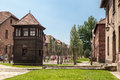 Auschwitz concentration camp the brick barracks a fence and a protection wood tower for the guards in south of poland Stock Image