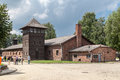 Auschwitz concentration camp the brick barracks and a protection wood tower for the guards in south of poland Stock Image