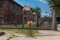 Auschwitz concentration camp a fence and the brick barracks in south of poland Stock Images