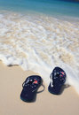 Aussie thongs on on the beach holiday patriotic featuring australian flag Stock Images