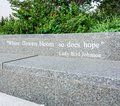 AUSTIN TEXAS- SEPTEMBER 17, 2017:Quote:  `Where flowers bloom so does hope` by Lady Bird Johnson on a bench outside The Lyndon B Royalty Free Stock Photo