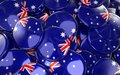 Australia Badges Background - Pile of Australian Flag Buttons. Royalty Free Stock Photo