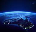 Australia with city lights from space at night earth daytime series Stock Images