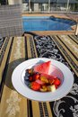 Australia outdoor breakfast by pool fresh fruit salad swimming Royalty Free Stock Photo