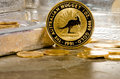 Australian Gold Nugget Coin with Silver Bars in Background Royalty Free Stock Photo