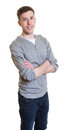 Australian guy in a grey shirt with crossed arms Royalty Free Stock Photo