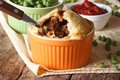 Australian meat pie in a pot on a background of green pea Royalty Free Stock Photo