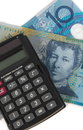 Australian money cash and calculator over white Stock Images
