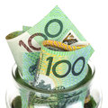 Australian money in jar over white background one hundred dollar bills Royalty Free Stock Images
