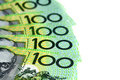 Australian one hundred dollar bills fanned over white background Stock Image