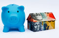 Australian Origami Money House with Piggy bank Royalty Free Stock Photo
