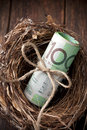 Australian superannuation nest egg money a with a roll of on a wood background Royalty Free Stock Photo