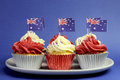 Australian theme red white and blue cupcakes with national flag for australia day anzac day or holiday against a Royalty Free Stock Photo