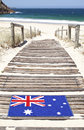 Australian welcome mat beach an flag at zenith nsw australia near shoal bay in the port stephens area Royalty Free Stock Photo
