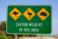 Australian wildlife sign an depicting a kangaroo an emu and an echidna situated next to the indian ocean road in western australia Stock Photo