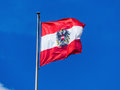 Austria flag the austrian waving in the wind against a blue sky Royalty Free Stock Images