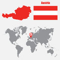 Austria map on a world map with flag and map pointer. Vector illustration
