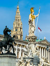 Austria vienna parliament the in with the statue of pallas athena of the greek goddess of wisdom Royalty Free Stock Images